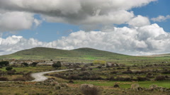 Clouds in the hill landscape timelapse, there's a storm coming Stock Footage