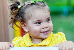 Portrait of little smiling child girl - stock photo