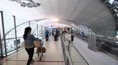 Passengers arrive at check-in boarding at Suvarnabhumi Airport Stock Footage
