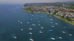 UDH Lake Geneva aerial shot - City of Morges Stock Footage