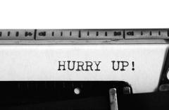 Typing text: hurry up ! Stock Photos