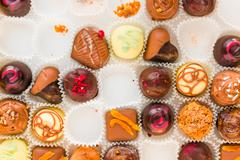 Incomplete box of delicious handmade chocolates closeup Stock Photos