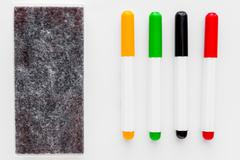Four markers and felt for office white whiteboard isolated Stock Photos