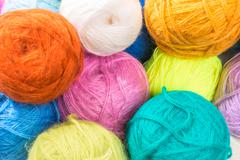 a bunch of multi-colored woolen threads closeup - stock photo