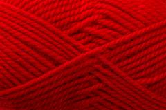 red woolen thread is wound beautiful closeup - stock photo