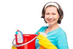 Horizontal portrait of the 30 year old housewife on a white background Stock Photos