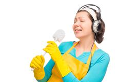 humorous photo housewife with headphones and a cleaning brush toilet isolated - stock photo