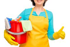 Woman with a red bucket in an apron and gloves on a white background Stock Photos