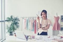 Dressmaker in studio Stock Photos