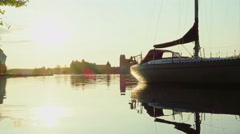 Sunset on the lake with yacht and Trakai Castle Stock Footage