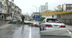 Large Debris Blocks Street In Front Of Damaged Car Major Hurricane Aftermath Stock Footage