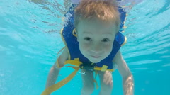 Boy in lifejacket in pool Stock Footage