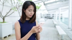 Woman using mobile phone at outdoor - stock footage