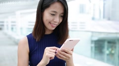 Woman use of mobile phone at outdoor - stock footage