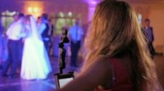 singer at the wedding party woman dancing restaurant lights back - stock footage