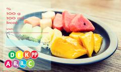 Plate of fruits with calories and vitamin chart Stock Photos