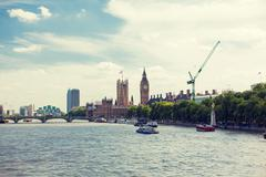 Houses of Parliament and Westminster bridge - stock photo