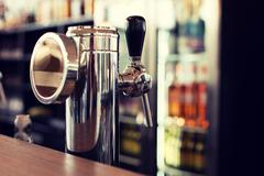 Close up of single tap chrome draft beer tower Stock Photos