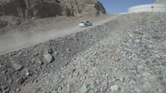 Car rally through mountains Stock Footage