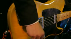 Playing yellow electric guitar fingers in the dark at the party Stock Footage