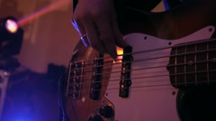 Guitarist playing electric guitar at the wedding party in violet lights Stock Footage
