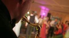 saxophone playing at the wedding party dancing people flashing lights - stock footage
