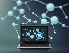 Laptop computer with molecules structure on screen Kuvituskuvat