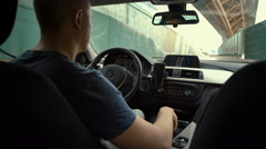 Man behind the wheel, seen from behind. The young man behind the wheel of a car Stock Footage