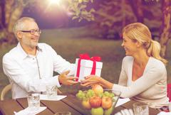 Happy family having holiday dinner outdoors Stock Photos