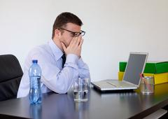 Office worker feeling pain because of headache - stock photo