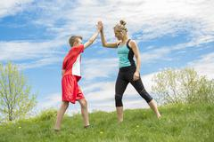 Family, mother and son are running or jogging for sport outdoors Stock Photos