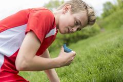 Teenager boy in sportswear run outside Stock Photos