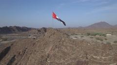 UAE flag on mountain Stock Footage