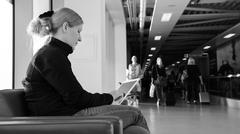 Young woman using her digital tablet pc at an airport lounge. Kuvituskuvat