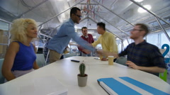 4K Time lapse of busy creative business team working hard in trendy office Arkistovideo