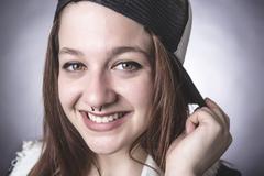 Urban girl in studio posing with attitude Stock Photos