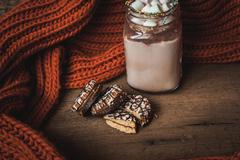 Glass Cup with cocoa and marshmallows, chocolate chip cookies and orange scar Stock Photos