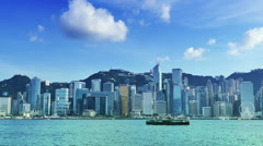 Hong Kong skyline with a reflection from a skyscraper.bluesky Stock Footage