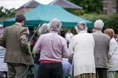 Older generation, seniors, enjoying an outdoors music, culture, community Stock Photos