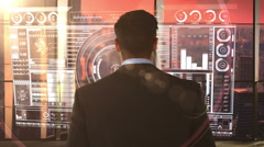 Businessman in office with futuristic city background and projection Stock Footage