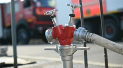 Firefighter water hose connected to hydrant Stock Footage