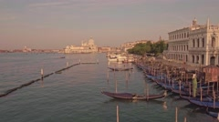 Drone aerial flying over parking gondolas with the San Marco square view Stock Footage