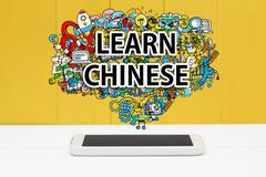 Learn Chinese concept with smartphone Stock Photos