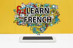 Learn French concept with smartphone Stock Photos