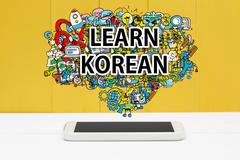 Learn Korean concept with smartphone Stock Photos