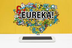 Eureka concept with smartphone Stock Photos