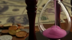 Pink sand hourglass. Close up Stock Footage