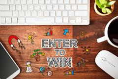 Enter to Win concept with workstation Stock Photos