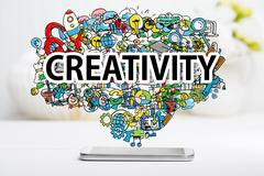 Creativity concept with smartphone - stock photo