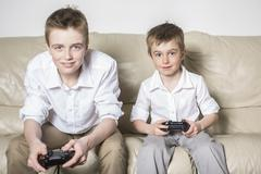 Boys having lots of fun with video games Kuvituskuvat
